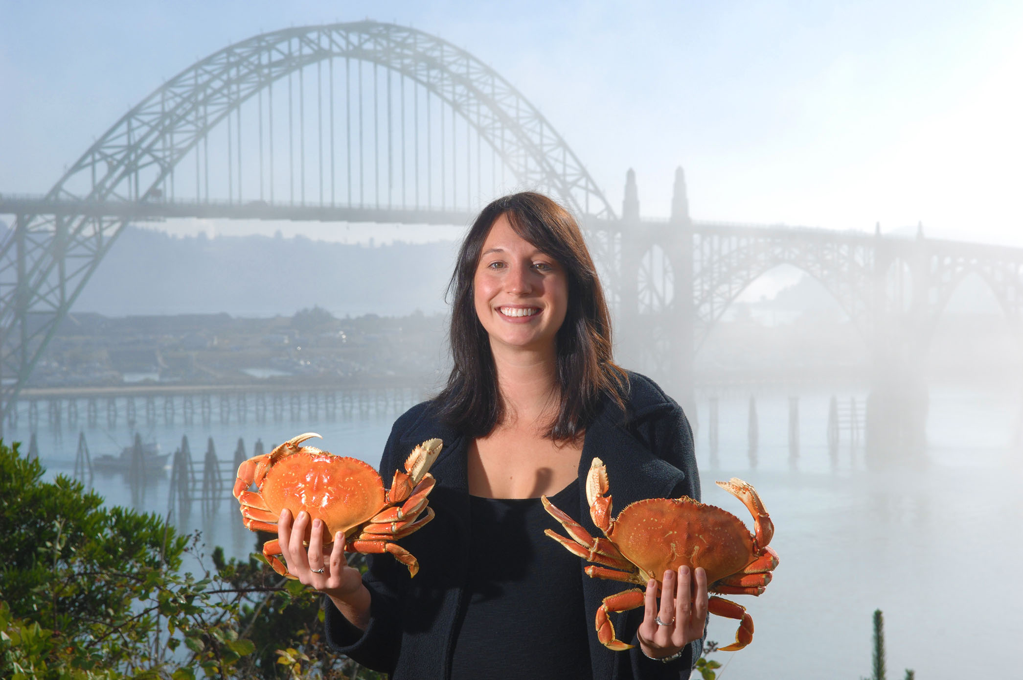 lady holding two dungeness crabs photo